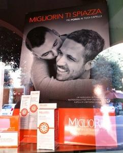 Pubblicità esposta in vetrina di un'erboristeria in centro a Bologna. L'Italia è già cambiata nonostante Chiesa e politica